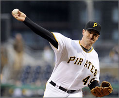 Pirates starter Ross Ohlendorf threw a two-hitter over seven innings, helping Pittsburgh blank the Marlins 8-0 to end Florida's seven-game winning streak.
