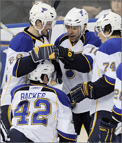 David Backes, bottom, and T.J. Oshie (No. 74) will be flying to Switzerland to join Team USA at the world championships.