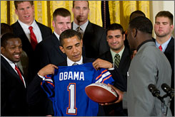 Barack Obama receives a Florida football jersey while hosting the reigning college football national champions.