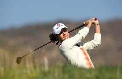 Lorena Ochoa tees off at the first round of the Corona Championship at the Tres Marias Residential Golf Club in Morelia, Mexico. Her 8-under 65 was good for the lead after one round.