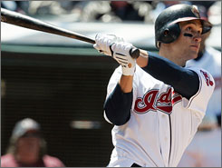 Indians'       Grady Sizemore hits a three-run home run off Royals pitcher       Ron Mahay in the eighth inning to give the Indians the lead and 5-2 win.