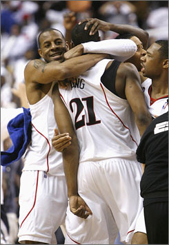 Andre Iguodala hugs teammate Thaddeus Young after the latter connected on a driving layup with 2 seconds left to lift the Sixers to a Game 3 win.