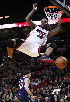 The Heat 's Udonis Haslem throws down a dunk against the Atlanta Hawks during the first quarter. Haslem tallied 12 points and 13 rebounds as Miami cruised to a 107-78 win.