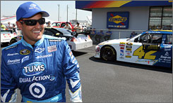 Juan Pablo Montoya has reason to smile after exiting his car with the fastest qualifying lap at Talladega Superspeedway.