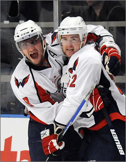 Washington's Alex Ovechkin and Mike Green celebrate Green's first-period goal in Game 6 against the New York Rangers on Sunday afteroon. The series moves to Washington for Game 7.
