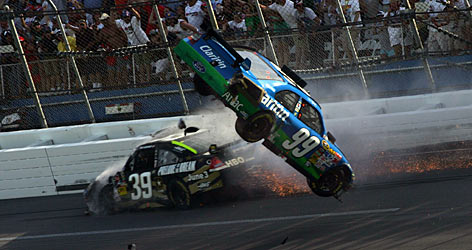 Carl Edwards' car flies through the air after colliding with the Chevy of Ryan Newman in the last lap at Talladega Superspeedway.