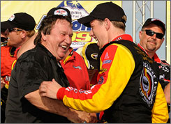 Team owner James Finch joins Brad Keselowski in the victory lane celebration after the rookie driver's first Sprint Cup win.