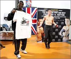 "While Ricky Hatton jumps rope, Floyd Mayweather Sr. holds up a T-shirt Freddie Roach sent him as a gag gift. The shirt reads ""Freddie Roach's FightingFit.com, The Undisputed Weight Loss Champion."" Mayweather wrote ""Too late"" at the bottom, saying Hatton is already in shape for his bout with Manny Pacquiao."