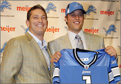 Lions chairman Bill Ford Jr. took issue with his new employee, Matthew Stafford, right, driving a Chevrolet.