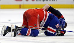 New York's Blair Betts struggles to get up after he took a hit to the head from Washington's Donald Brashear during Game 6 of their playoff series on Sunday afternoon. Brashear was suspended six games for the hit and other antics.