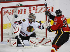 Blackhawks goalie Nikolai Khabibulin stopped 43 Flames shots, including Craig Conroy's first-period attempt, as Chicago won its first playoff series since 1996.