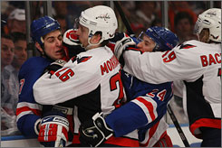 The Rangers' Brandon Dubinsky, left, accused Capitals' defenseman Shaone Morrisonn of biting him during Game 6 of their Eastern Conference quarterfinal series in New York.