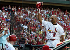 Albert Pujols takes a bow after clearing the bases on April 25 vs. the Cubs, one of his two grand slams thus far this season.