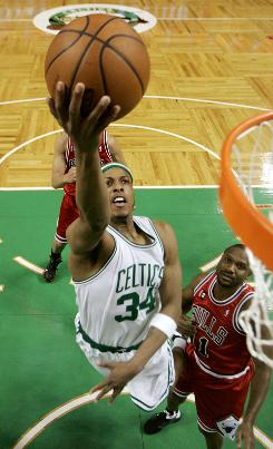 Boston's Paul Pierce goes to the basket past the Bulls' Lindsey Hunter. Pierce's play in the final minutes of the game was key in the Celtics' home victory over Chicago, which pushed the series 3-2 in favor of Boston.