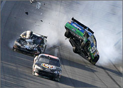 Carl Edwards' car lifts off the ground after colliding with Brad Keselowski and Ryan Newman on the final lap at Talladega last weekend. NASCAR officials said Edwards' roof flaps worked properly, but that the impact with Newman's car cause Edwards to corkscrew skyward.