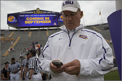 LSU football coach Les Miles is among the coaches who have joined Twitter. Here, he sends out a tweet before the Tigers' spring football game.
