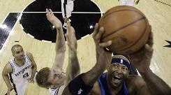 The Mavericks' Erick Dampier shoots over San Antonio defender Matt Bonner. Dallas had their way with the playoff-tested Spurs, easily winning 106-93 to win the series 4-1.