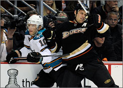 Ryan Getzlaf, right, helped the Ducks upset Christian Ehrhoff and the top-seeded Sharks in the first round with big hits. Getzlaf and Co. now have their targets set on the second-seeded Red Wings.