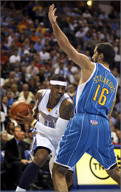 Carmelo Anthony, driving around the Hornets' Peja Stojakovic during Game 5, scored 34 points to help the Nuggets win their first playoff series since 1994 and secure a second-round date with the Mavericks.