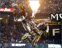 James Stewart leads Chad Reed en route to winning the Jan. 10 Monster Energy Supercross race at Chase Field in Phoenix. Stewart tops the Supercross standings with Reed in second heading into Saturday's season finale.