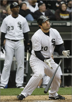 The White Sox's    Carlos Quentin watches his solo home run in the seventh inning against the Mariners.