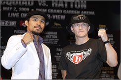 British boxer Ricky Hatton, right, and Manny Pacquiao of the Philippines pose for photos during Wednesday's news conference at the MGM Grand in Las Vegas.