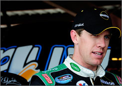 Carl Edwards waits out a break in practice Friday at Richmond International Raceway.