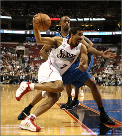 Andre Miller, left, driving to the basket against the Magic's Rafer Alston in Game 6, skipped the 76ers final team meeting on Friday, along with center Theo Ratliff (not shown).