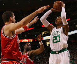 Boston guard Ray Allen shoots over Chicago's Brad Miller, left, and Ben Gordon during Game 7. Allen scored 23 points as the Celtics won a first-round playoff series in seven games for the second straight year.