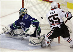 The Blackhawks' Ben Eager scores one of Chicago's six goals against Canucks goalie Roberto Luongo during the third period of Game 2.