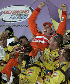 Kyle Busch falls into his crew's arms in Victory Lane at Richmond International Raceway.