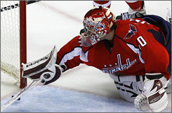Washington's rookie goalie Simeon Varlamov reached back and knocked away        Sidney Crosby's shot in the second period to help the Capitals win Game 1 of the Eastern Conference semifinals 3-2.