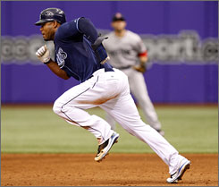 Rays'  Carl Crawford ties a modern major league record with six stolen bases.