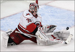 Hurricanes goalie Cam Ward stopped 36 Bruins shots to record his second playoff shutout in four games while helping snap Bruins goalie Tim Thomas' 11-game winning streak.