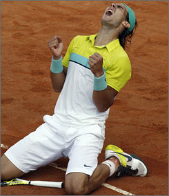 Rafael Nadal celebrates his record fourth title at the Rome Masters.
