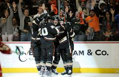 Anaheim's Teemu Selanne celebrates with teammates Andrew Ebbett and Ryan Carter after scoring against the Red Wings. The Ducks topped Detriot 2-1 in Game 3 of the Western Conference semifinal series in Anaheim.