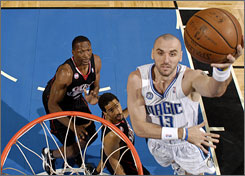 Magic center Marcin Gortat, right, has been impressive backing up Dwight Howard this season.