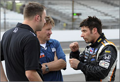 Alex Tagliani, right, with crewmen Brandon Fry, left, and Mike Culliver, is one of four Indy 500 rookies to have completed his mandatory test.