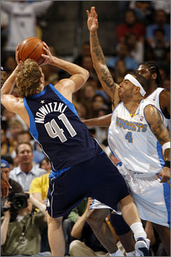 A physical Kenyon Martin plays Mavericks' Dirk Nowitzki tough in Game 1 of the Western Conference semifinals.