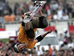 American Andy MacDonald performs Sunday in the X Games Asia in Shanghai.