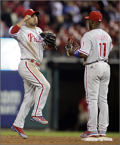 Phillies center fielder Shane Victorino, left, and shortstop Jimmy Rollins celebrate after defeating the Cardinals 10-7. Victorino went 4-for-5 with a home run and three RBI.