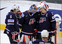 Americans Ron Hainsey, Robert Esche and Dustin Brown celebrate their world championship quarterfinal win over Finland on Wednesday. The Americans will face Russia in the semifinals.