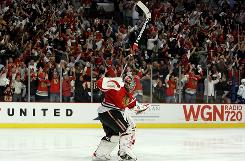 Chicago goaltender    Nikolai Khabibulin celebrates along with the fans after the Blackhawks won 2-1 in overtime against the Vancouver Canucks in Game 4 of the Western Conference semifinals.