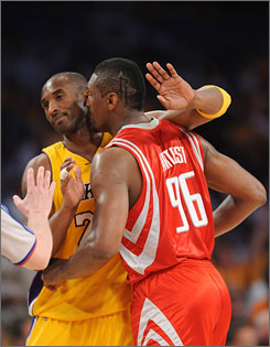 The Lakers' Kobe Bryant, left, and the Rockets' Ron Artest get tangled up in Game 2 of their series.