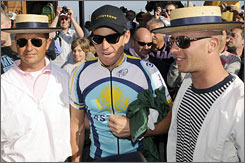 Lance Armstrong, center, poses with gondoliers in Venice. This year's Giro d'Italia begins on Saturday in Venice and will end on May 31 in Rome.