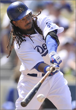 Dodgers slugger Manny Ramirez singles against the Colorado Rockies last month.