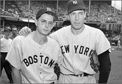 Dom DiMaggio, left, and his brother Joe pose before a the All-Star Game at Ebbets Field on July 12, 1949.