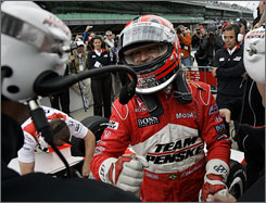Helio Castroneves is congratulated by his crew after qualifying on the pole for the Indianapolis 500 for the third time in his career.