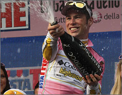 British cyclist Mark Cavendish of Columbia-High Road celebrates his team's opening stage time trial win at the Giro d'Italia on Saturday.