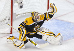 Bruins goalie Tim Thomas, making the glove save during the first period, stopped all 19 Carolina shots to earn his first NHL playoff shutout.